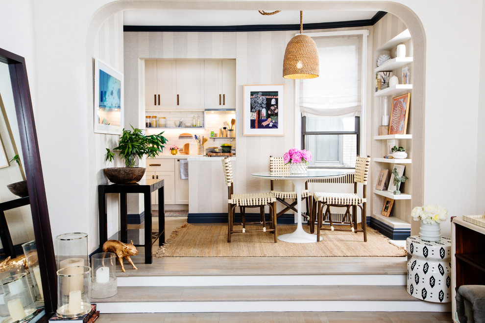 Kitchen/dining room combo - small transitional light wood floor and beige floor kitchen/dining room combo idea in New York with multicolored walls and no fireplace