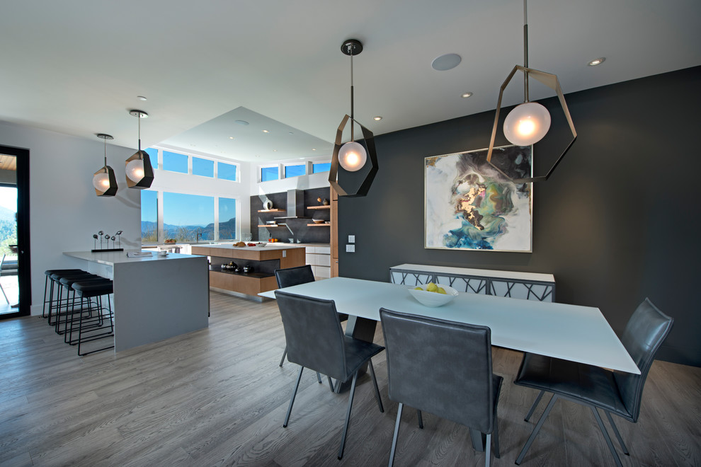 Inspiration for a contemporary dark wood floor and gray floor great room remodel in Other with black walls