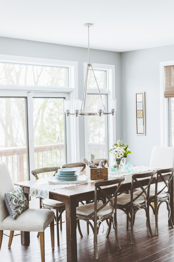 Inspiration for a shabby-chic style dark wood floor dining room remodel in Minneapolis with gray walls