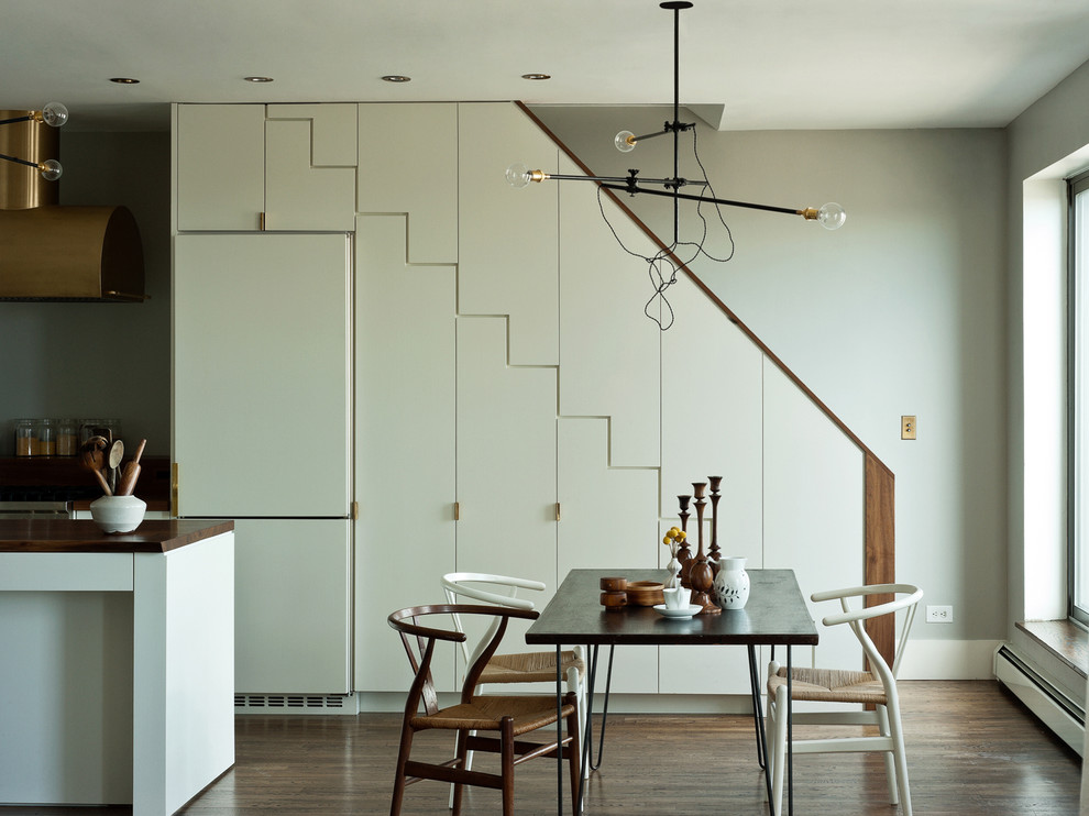 Minimalist dark wood floor kitchen/dining room combo photo in New York with gray walls