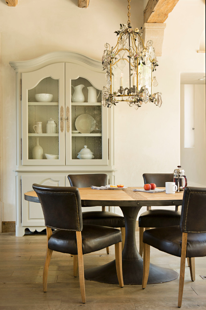 Dining room - mediterranean dining room idea in Orange County with white walls