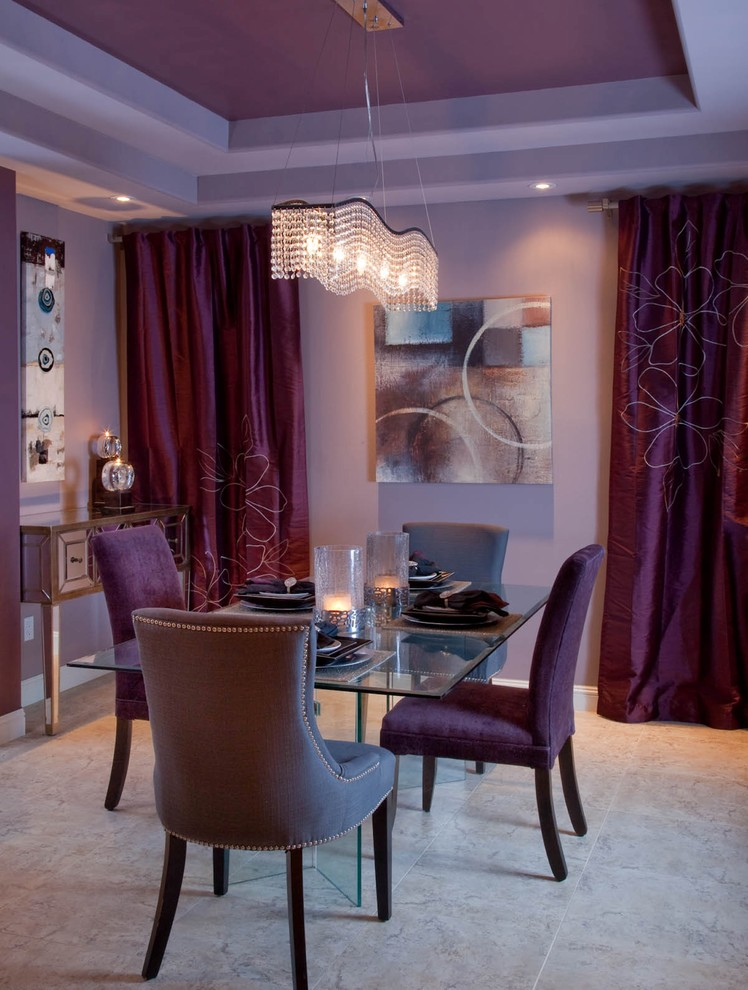 Example of a trendy dining room design in San Diego with purple walls
