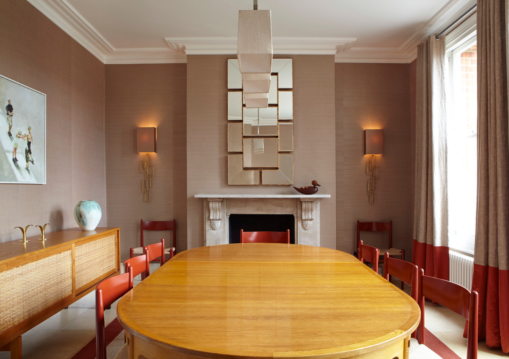 Dining room - contemporary dining room idea in London with brown walls and a standard fireplace