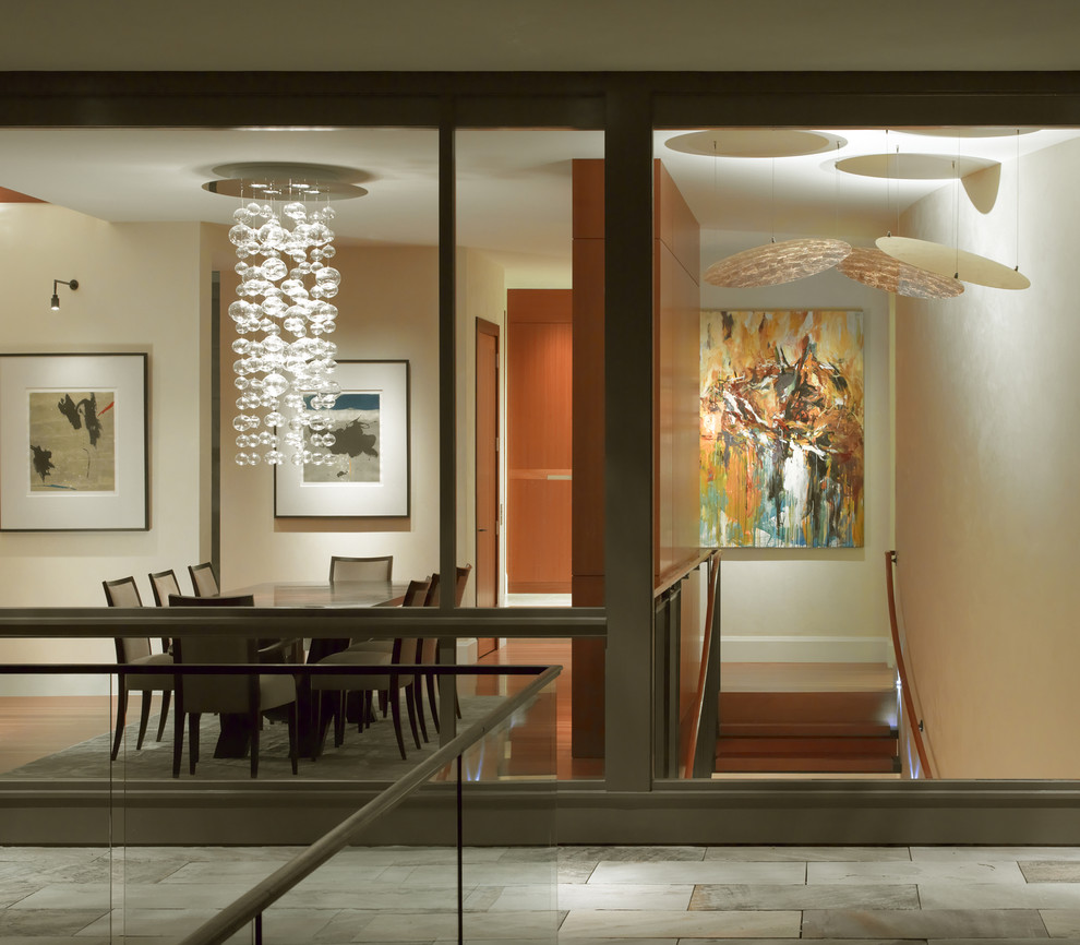 Trendy medium tone wood floor dining room photo in San Francisco with beige walls