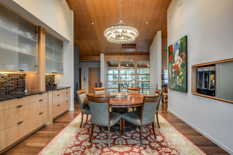 Enclosed dining room - mid-sized modern dark wood floor enclosed dining room idea in Seattle with white walls and no fireplace