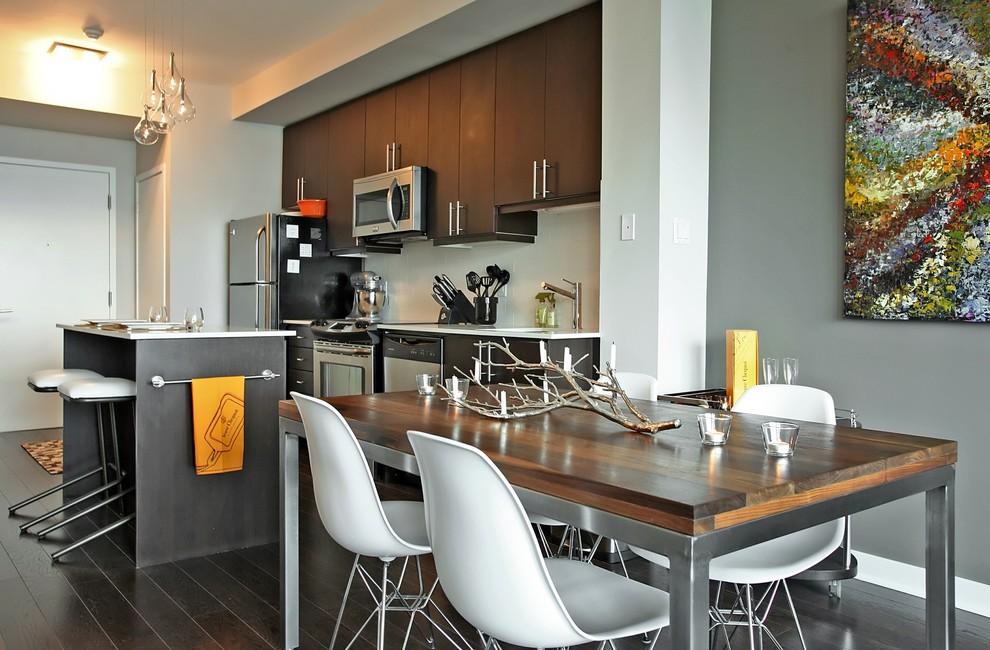 Small trendy dark wood floor kitchen/dining room combo photo in Toronto with gray walls