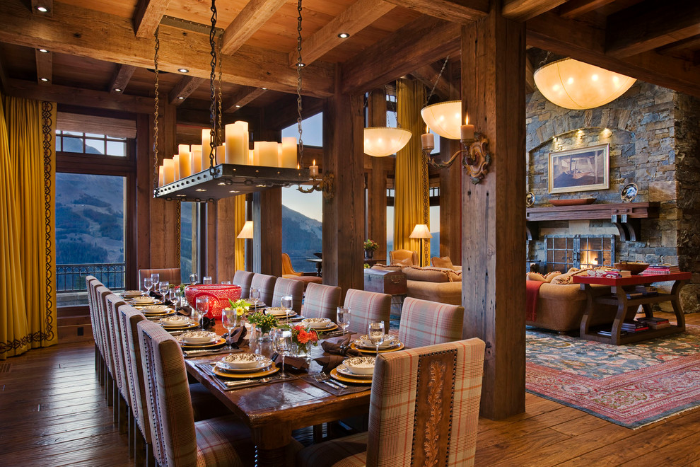 Example of a mountain style dark wood floor dining room design in Other