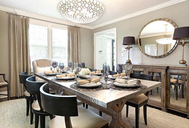 Inspiration for a contemporary enclosed dining room remodel in New York with beige walls