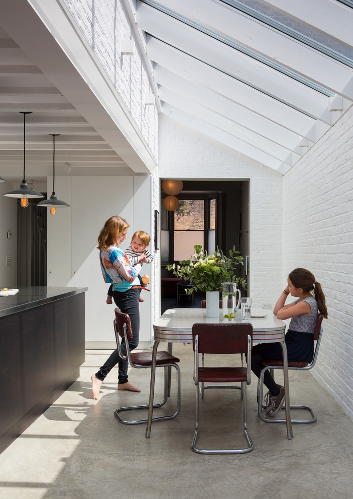 Photo of a contemporary dining room in London.