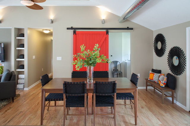 Red Barn Door With Full View Of Dining Table Transitional
