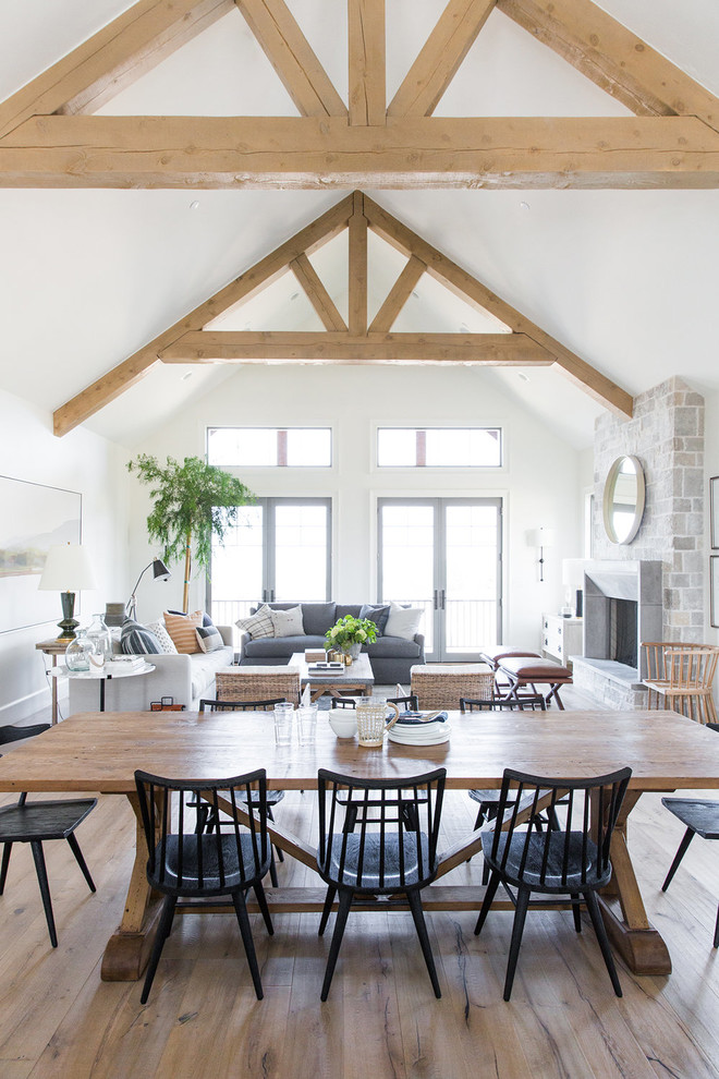 Example of a mid-sized cottage dark wood floor dining room design in Salt Lake City with white walls