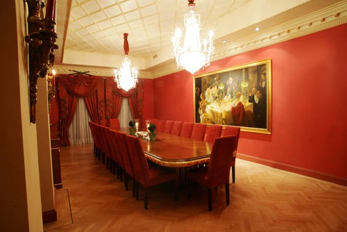 Red walls traditional dining room