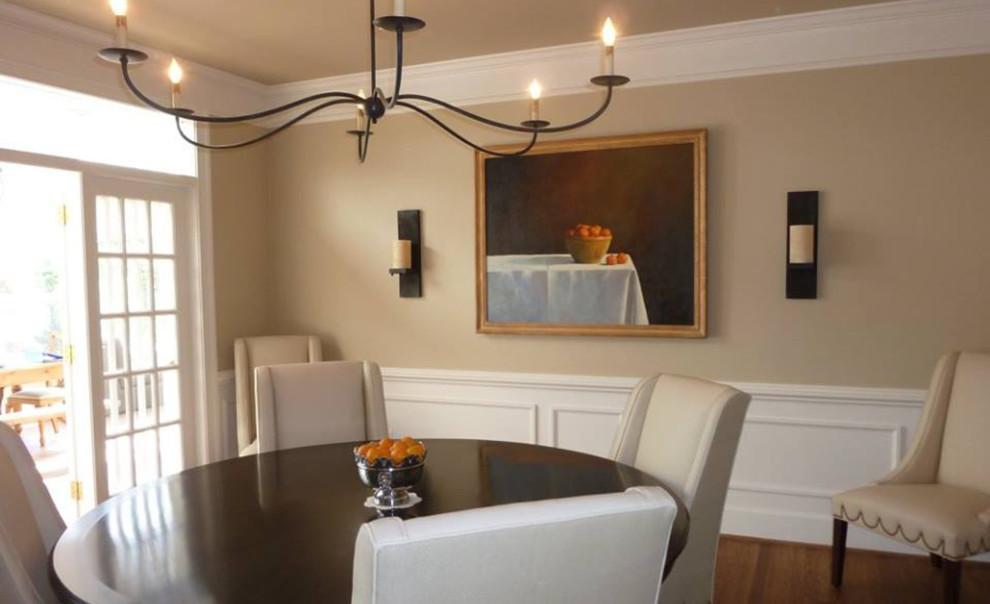 Dining room - country dark wood floor and brown floor dining room idea in DC Metro with beige walls