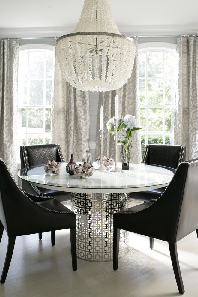 Inspiration for a contemporary light wood floor dining room remodel in Raleigh with gray walls