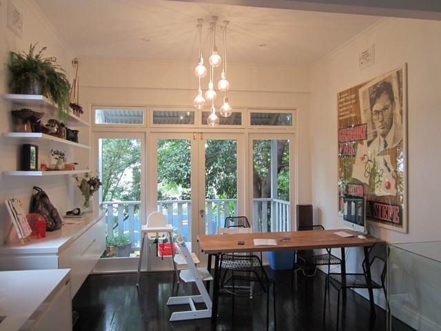 Photo Of A Small Modern Kitchen Dining Combo In Sydney With White Walls Dark