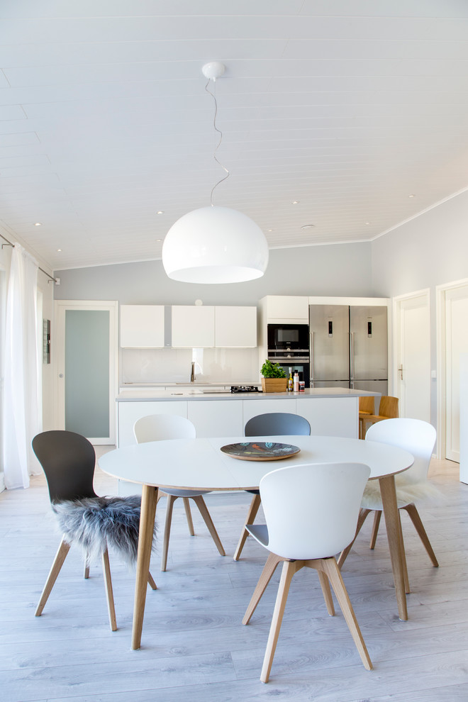 Inspiration for a mid-sized scandinavian light wood floor kitchen/dining room combo remodel in Other with gray walls