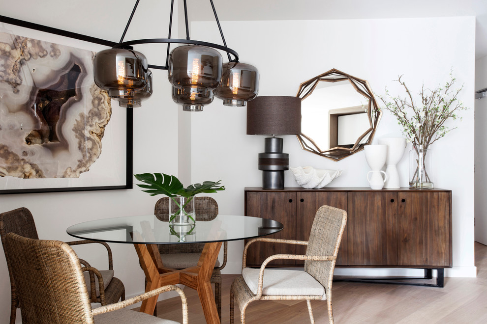 Dining room - contemporary light wood floor dining room idea in Melbourne with white walls