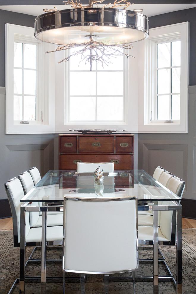 Dining room - transitional medium tone wood floor dining room idea in Charlotte