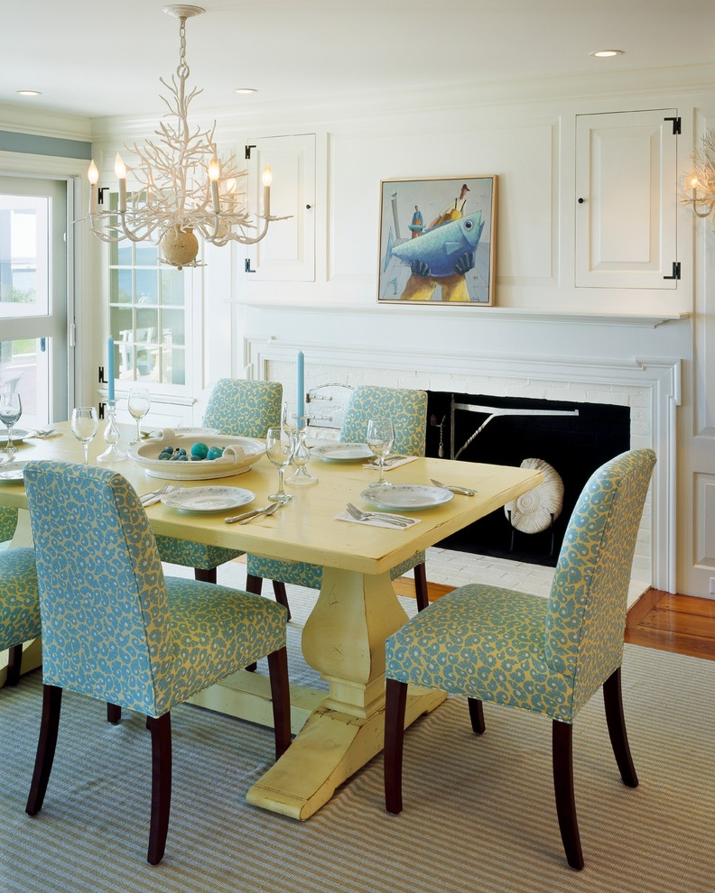 Dining room - coastal dark wood floor dining room idea in Boston with white walls, a standard fireplace and a brick fireplace