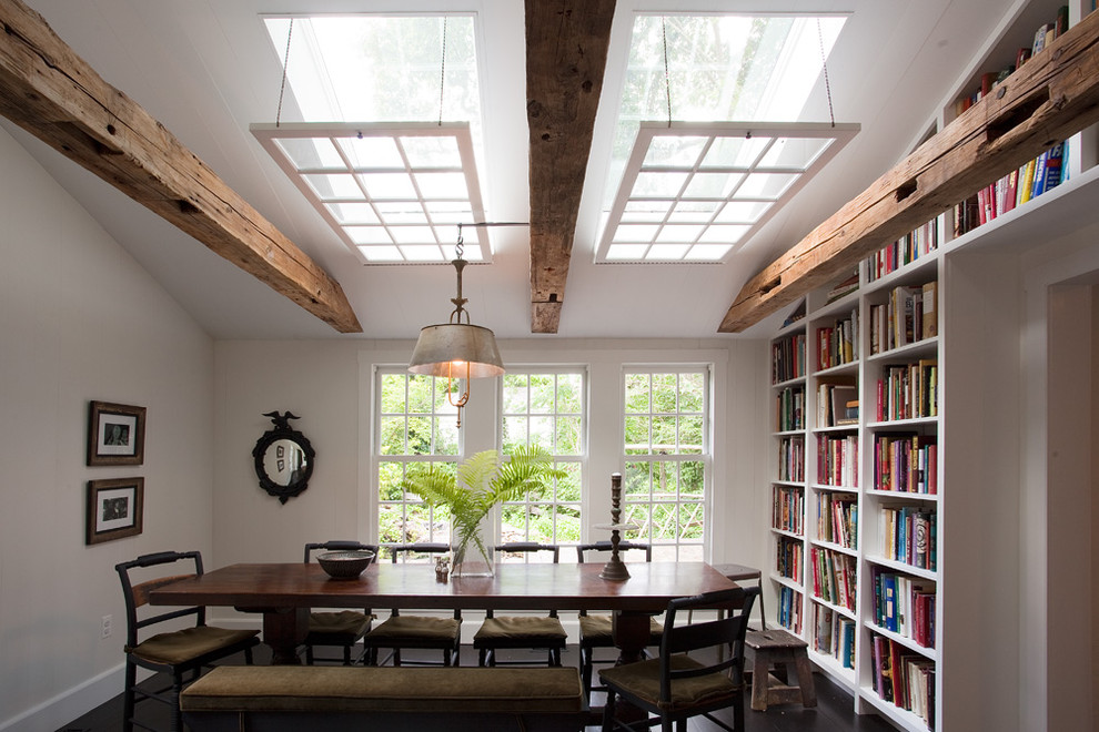 Mountain style dark wood floor dining room photo in Philadelphia with white walls