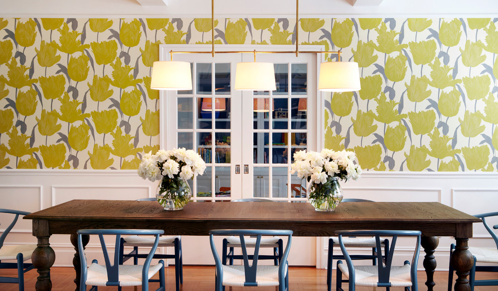 Enclosed dining room - large contemporary medium tone wood floor enclosed dining room idea in New York with multicolored walls and no fireplace