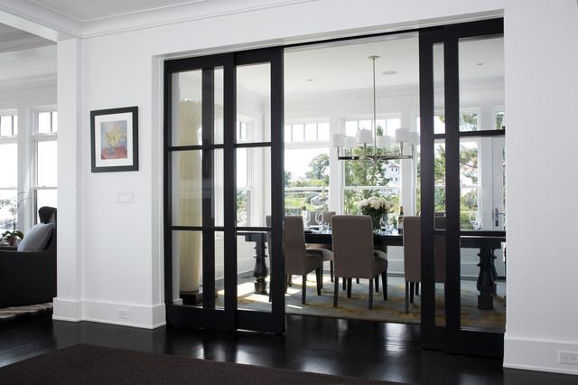 Enclosed dining room - transitional black floor enclosed dining room idea in Boston with white walls