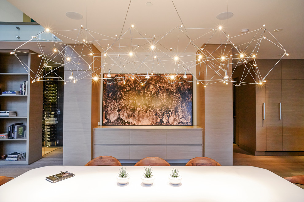 Example of a trendy light wood floor kitchen/dining room combo design in Vancouver with white walls