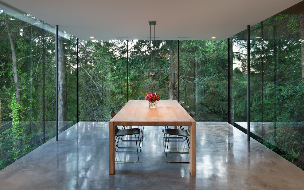 Example of a minimalist concrete floor dining room design in Vancouver