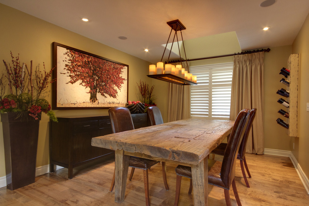 Example of a mountain style medium tone wood floor dining room design in Toronto with green walls
