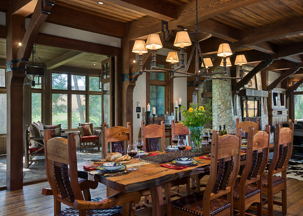 Dining room - rustic dark wood floor dining room idea in Other with white walls