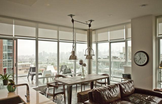 Rustic Industrial Urban Condo industrial-dining-room
