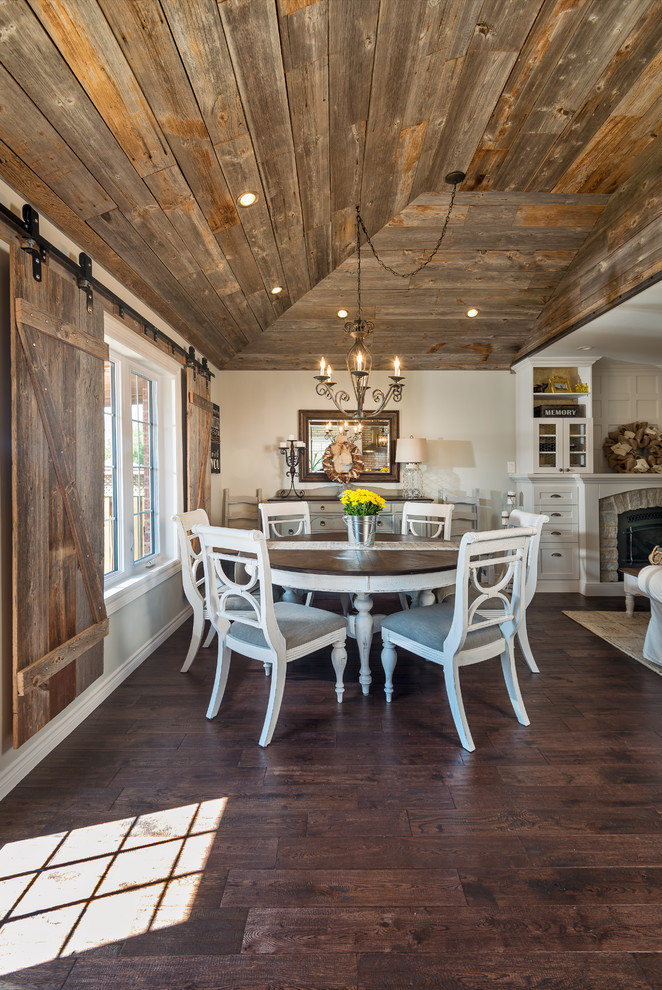 Great room - french country medium tone wood floor great room idea in Toronto with gray walls