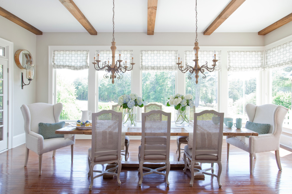 Example of a mid-sized country medium tone wood floor kitchen/dining room combo design in Atlanta with gray walls and no fireplace