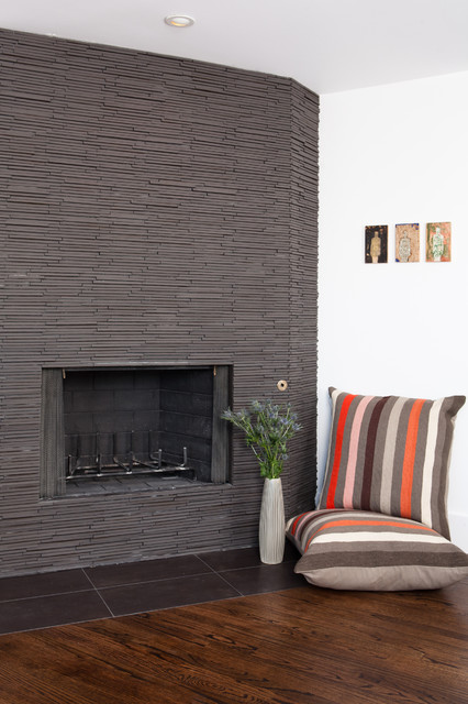 Textured tile from Spec Ceramics helped dress up this awkward corner fireplace without calling too much attention. Hearth tile: Ann Sacks porcelain.