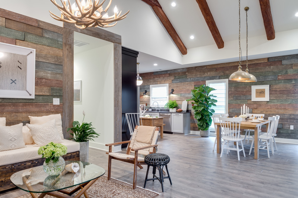 Great room - mid-sized transitional medium tone wood floor and gray floor great room idea in Atlanta with brown walls, a standard fireplace and a metal fireplace