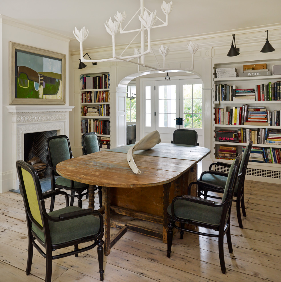 Enclosed dining room - mid-sized traditional light wood floor and beige floor enclosed dining room idea in New York with white walls, a standard fireplace and a wood fireplace surround