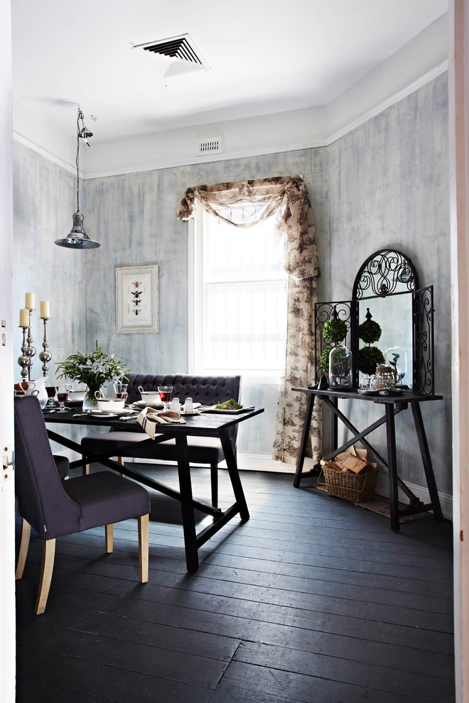 Example of a mid-sized dark wood floor and black floor kitchen/dining room combo design in Melbourne with metallic walls