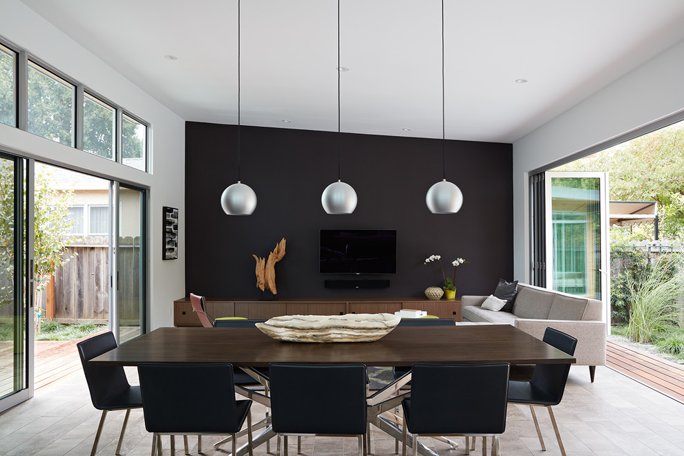 Inspiration for a mid-sized 1960s porcelain tile and beige floor great room remodel in San Francisco with black walls