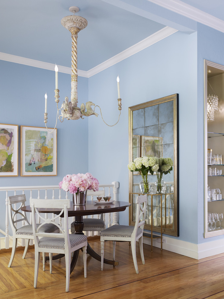 Example of a mid-sized cottage chic medium tone wood floor dining room design in San Francisco with blue walls