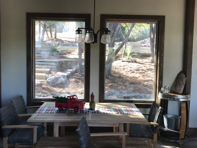 Mountain style dining room photo in Other