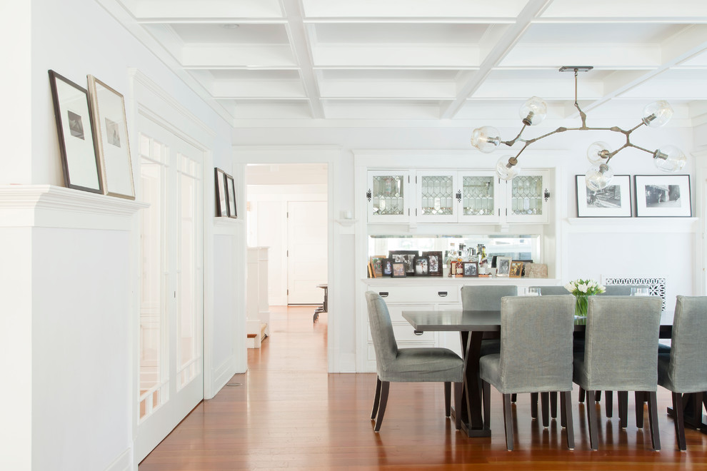 Example of a beach style dark wood floor dining room design in Los Angeles with white walls