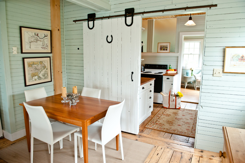 Inspiration for a timeless light wood floor dining room remodel in Portland Maine with green walls