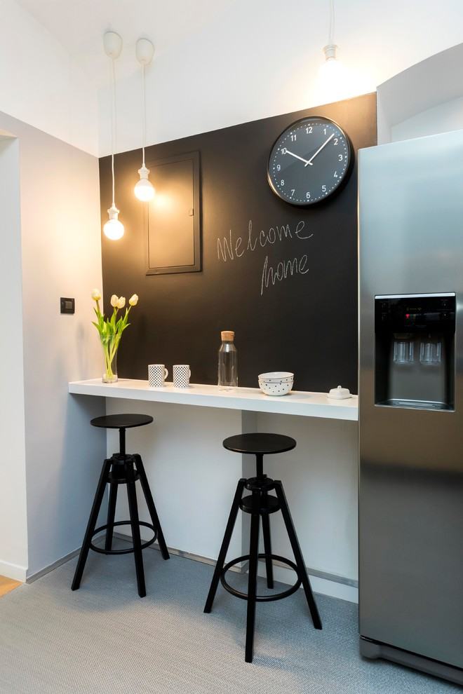 Inspiration for a small scandinavian light wood floor and beige floor kitchen/dining room combo remodel in Other with black walls and no fireplace