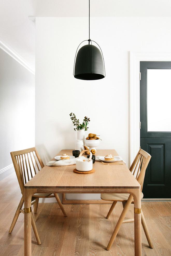 Kitchen/dining room combo - small scandinavian kitchen/dining room combo idea in Other with white walls