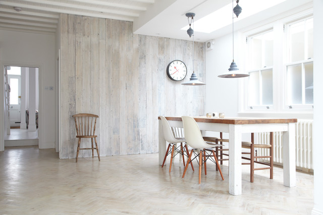 Inspiration for a scandinavian dining room in London with white walls, light hardwood flooring and beige floors.