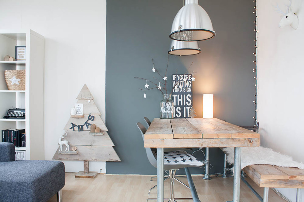 Danish light wood floor dining room photo in Amsterdam with gray walls