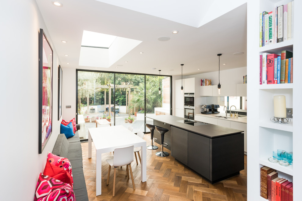 Inspiration for a mid-sized contemporary light wood floor and beige floor great room remodel in London