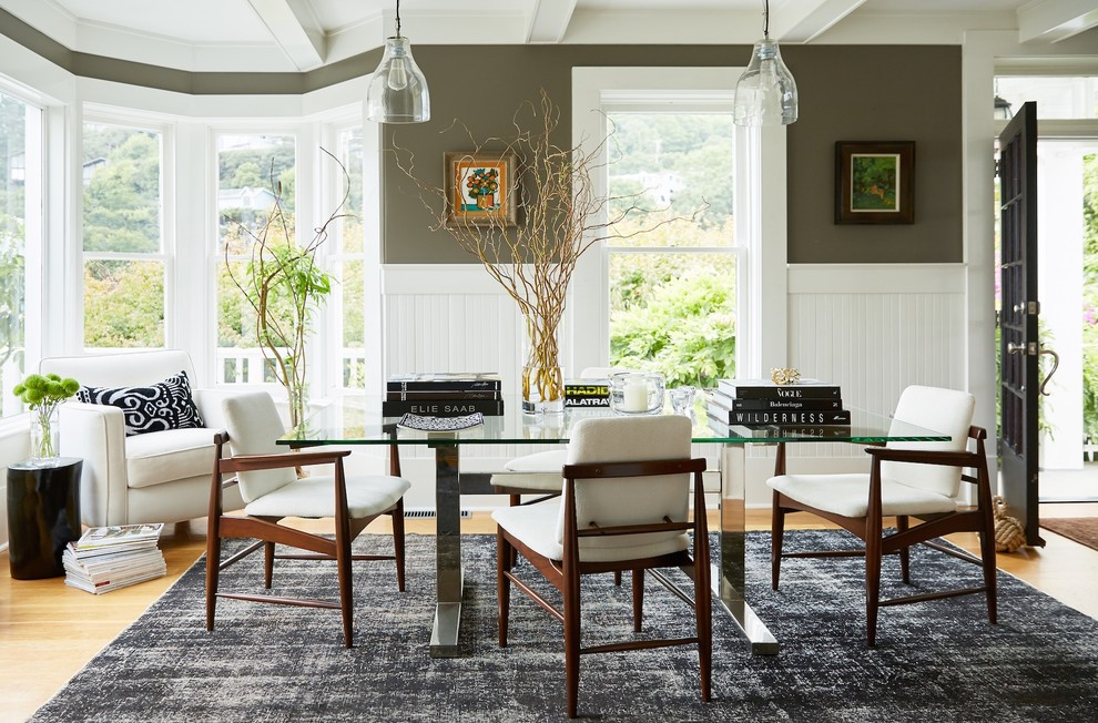 Inspiration for a transitional light wood floor and brown floor dining room remodel in San Francisco with green walls
