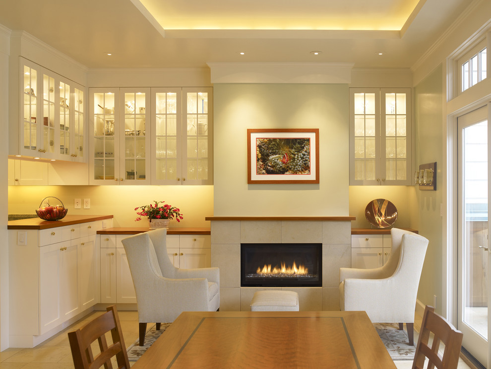 Dining room - traditional dining room idea in San Francisco with beige walls and a ribbon fireplace