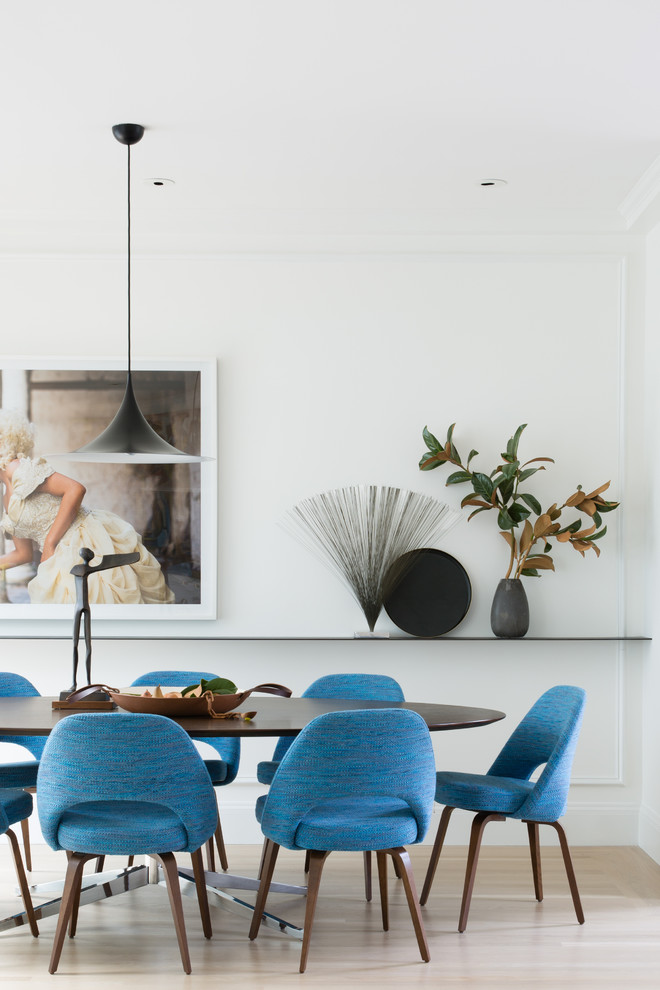 Mid-sized trendy light wood floor and beige floor enclosed dining room photo in San Francisco with white walls